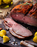 Beef pastrami sliced, roasted beef, slow cooking, marinated in olive oils eggplants on wooden board. Stock Photos