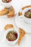 Beef pate with nut slices and cranberry in white cups with bread Royalty Free Stock Photos