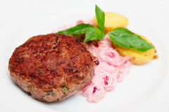 Beef patty cake with creamy sauce and potatoes Stock Image