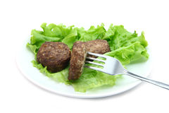 Beef Patty with lettuce on white background. Beef Patty steamed with lettuce on white background Stock Photography