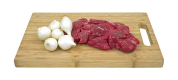 Beef and pearl onions on cutting board Stock Photos