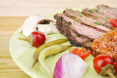 Beef on plate with peppers Royalty Free Stock Images