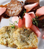 Beef Plate with Potatoes Galette stock images