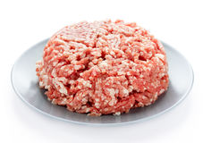 Beef or pork fat minced meat on plate. Isolated on white background Stock Image