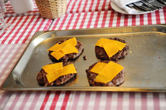 Beef or pork meat barbecue burgers with cheddar cheese stock image