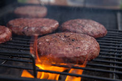 Beef or pork meat barbecue burgers for hamburger prepared grilled on fire flame grill Stock Image