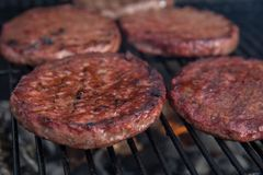Beef or pork meat barbecue burgers for hamburger prepared grilled on flame grill Royalty Free Stock Photos