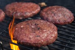 Beef or pork meat barbecue burgers for hamburger prepared grilled on flame grill Stock Photography