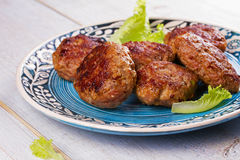Beef and Pork Patties in Blue Plate Stock Images