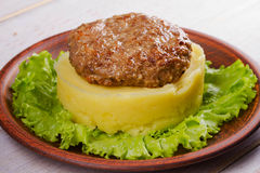 Beef and pork patty with smashed potato and lettuce Stock Photography