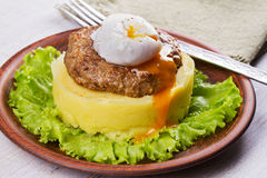 Beef and pork sausage patty with smashed potatoes and lettuce. Stock Photography