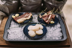 Beef, Pork, and Scallop Preparing for Cooking on Iced Plate Royalty Free Stock Photo