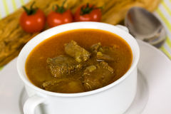 Beef post roast stew in bowl with spoon Stock Image