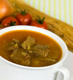 Beef post roast stew in bowl with spoon Stock Photography