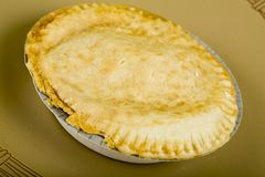 Beef Pot Pie. With golden pastry crust on plate Royalty Free Stock Photo