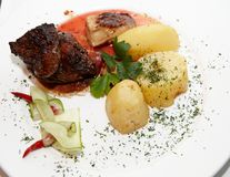 Beef with a potato a dish. Potatoes, prepared, dinner Royalty Free Stock Photos