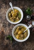 Beef potato massaman curry  on wooden background, top view. Comfort, delicious food Stock Images