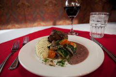 Free Beef Potatoes Carrots And Gravy For Dinner With A Glass Of Wine Stock Image - 128727621