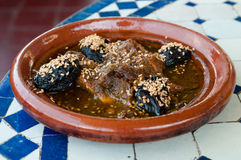 Beef with prunes. Prepared in traditional Moroccan tajine dish Stock Photos