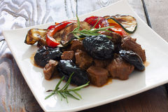 Beef with prunes and vegetables Royalty Free Stock Image