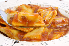 Beef ravioli with fork stock photo