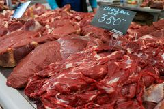 Beef. raw meat on the market. Together with the price list Royalty Free Stock Images