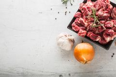 Beef. Raw sliced beef meat garlic onion salt pepper and rosemary.  Stock Photography