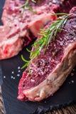 Beef raw steak. Raw fresh T-bone steak with salt pepper and rose Royalty Free Stock Photos