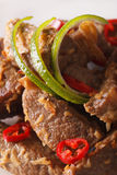 Beef rendang with coconut and spices macro. vertical Royalty Free Stock Image
