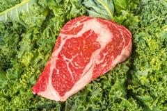 Beef rib eye on the salad leafs. Dry aged rib eye steaks on the salad leafs Royalty Free Stock Photography