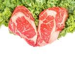 Beef rib eye on the salad leafs. Dry aged rib eye steaks on the salad leafs Royalty Free Stock Image