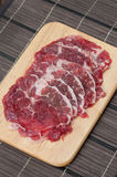 Beef Rib Eye Steak. On the Brown Wood Cutting Board Royalty Free Stock Photos