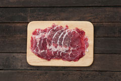 Beef Rib Eye Steak. On the Brown Wood Cutting Board Stock Image