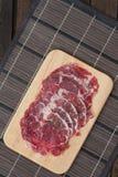 Beef Rib Eye Steak. On the Brown Wood Cutting Board Royalty Free Stock Photo