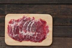 Beef Rib Eye Steak. On the Brown Wood Cutting Board Stock Photography