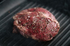 Beef rib eye steak on grill pan closeup Royalty Free Stock Photography