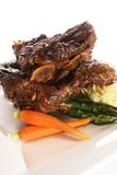 Beef ribs. With mashed potatoes, carrots and asparagus. Also available in horizontal royalty free stock images