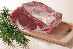 Beef ribs. And rosemary on a wooden cutting board stock images