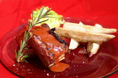 Beef ribs. With potatoes and red background Royalty Free Stock Photo