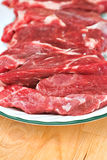 Beef Ribs. Fresh beef ribs with shallow DOF on a white platter royalty free stock image