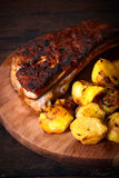 Beef ribs and baked potatoes Stock Images