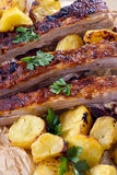 Beef ribs and baked potatoes Royalty Free Stock Image