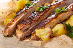 Beef ribs and baked potatoes Royalty Free Stock Images