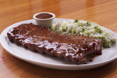 Beef ribs. With barbecue sauce with rice and broccoli stock photography