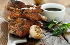 Beef ribs cooked grill wooden board copy space. Beef ribs cooked on a grill on a wooden board with copy space stock photography
