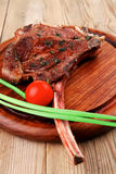 Beef ribs served with green chives Stock Photos