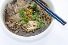 Beef Rice Noodles Soup. Thai Style Beef Rice Noodles Soup in White Bowl on White Fabric Background Royalty Free Stock Photography