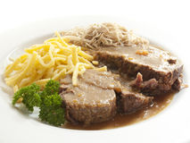 Beef roast. With spaetzle and salad as well as parsley Stock Photo
