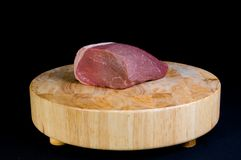Beef Roast. Close up of a fresh raw 3 pound beef round roast atop a butcher block table Stock Photo