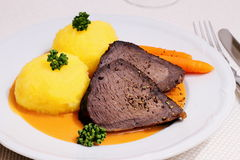 Beef roast, two dumplings in hunter sauce Stock Photography